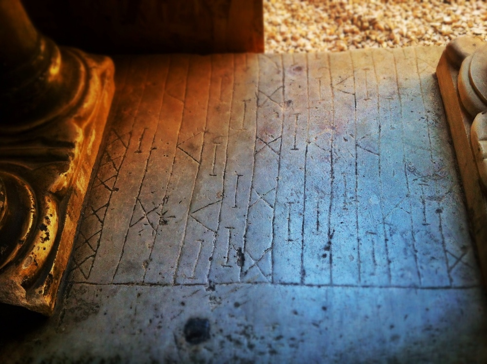 Ancient Roman game played on marble, looted from ruins and reused in the cloister of the  Santi Quattro Basilica