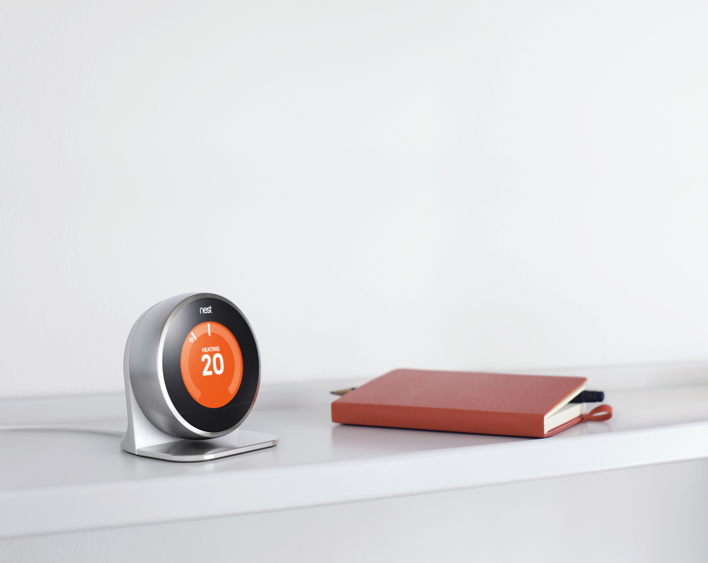 The Nest Thermostat and stand.
