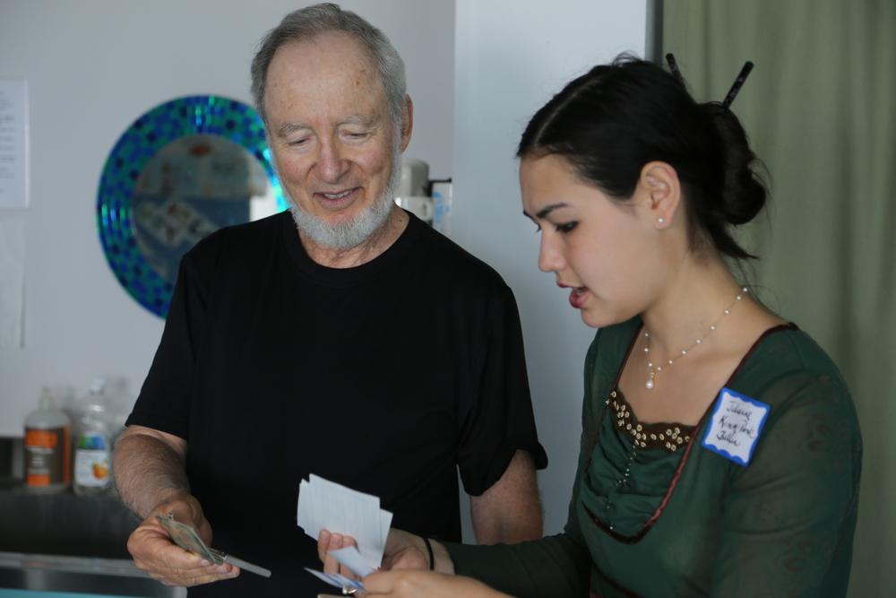 Julianne distributes nametags