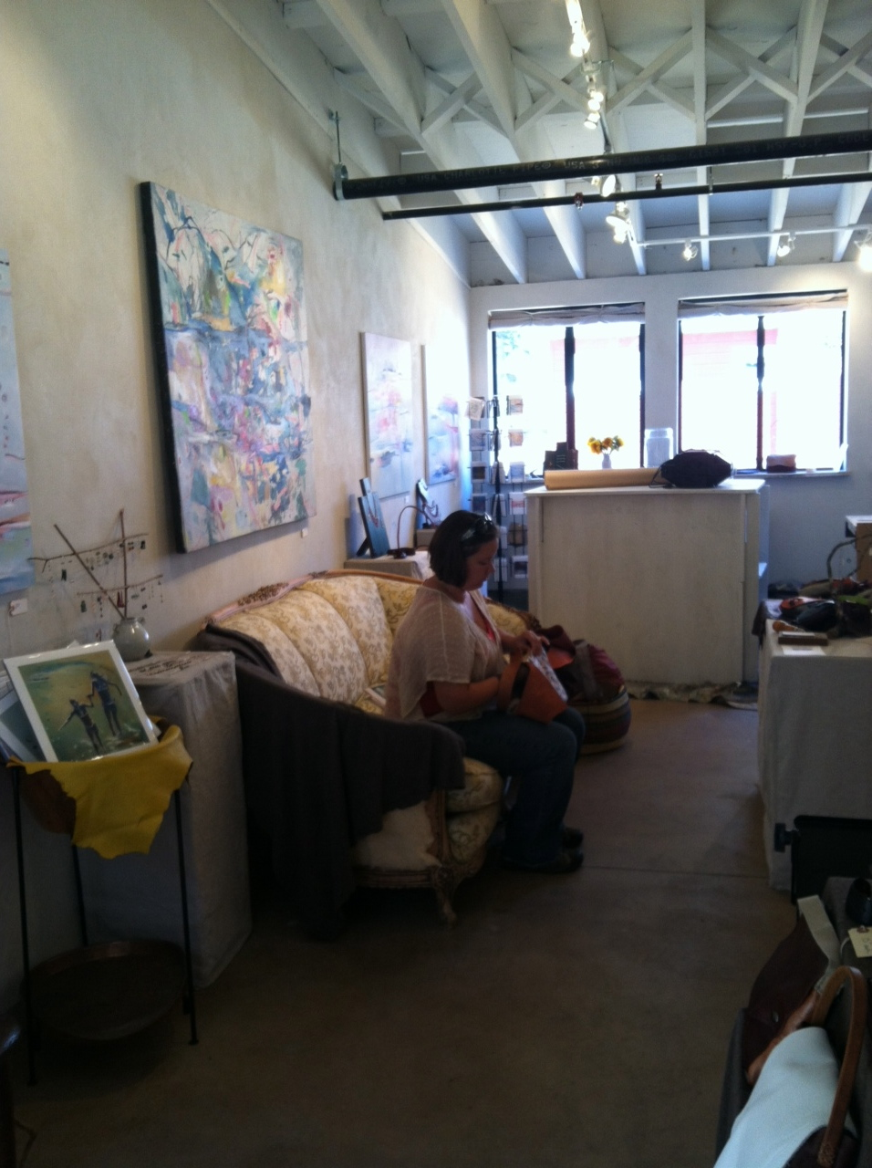 Crystal Liebold working on a leather handbag in her studio.