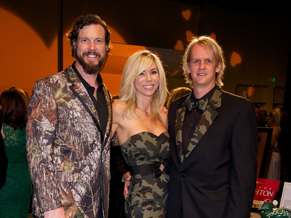 Rex Tucker, from left, with Marissa and Dr. Mark Mettauer (both wearing custom Couture House) at the camo-themed Montgomery County Heart Ball March 1, 2014. Photo by © Susan Lee