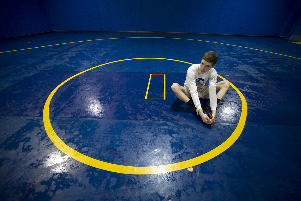 Wilson wrestler Jaryd Flank stretches on the mat before a drill session at Wilson Area High School. Express-Times Photo | MATT SMITH