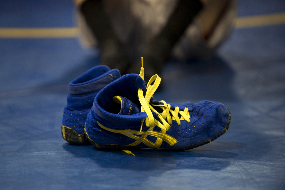 Wilson wrestler Jaryd Flank's wrestling shoes sit on the mat following a drill session at Wilson Area High School. Express-Times Photo | MATT SMITH