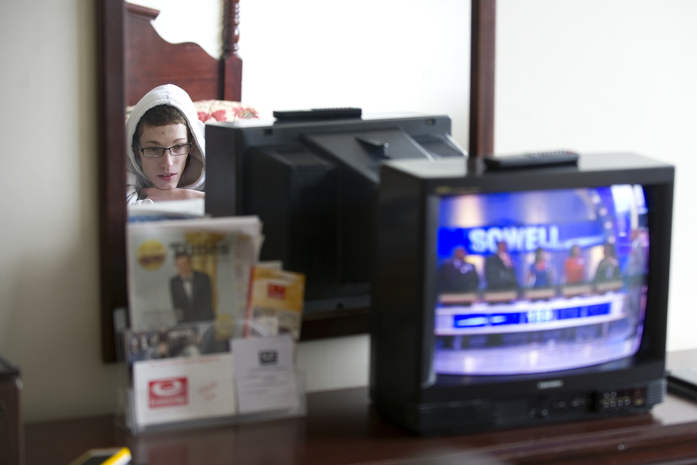 Wilson wrestler Jaryd Flank watches Family Feud on a television in a room at the Econo Lodge as he rests up before that evening's preliminary round of the PIAA southeast regionals at Wilson High School. Express-Times Photo | MATT SMITH