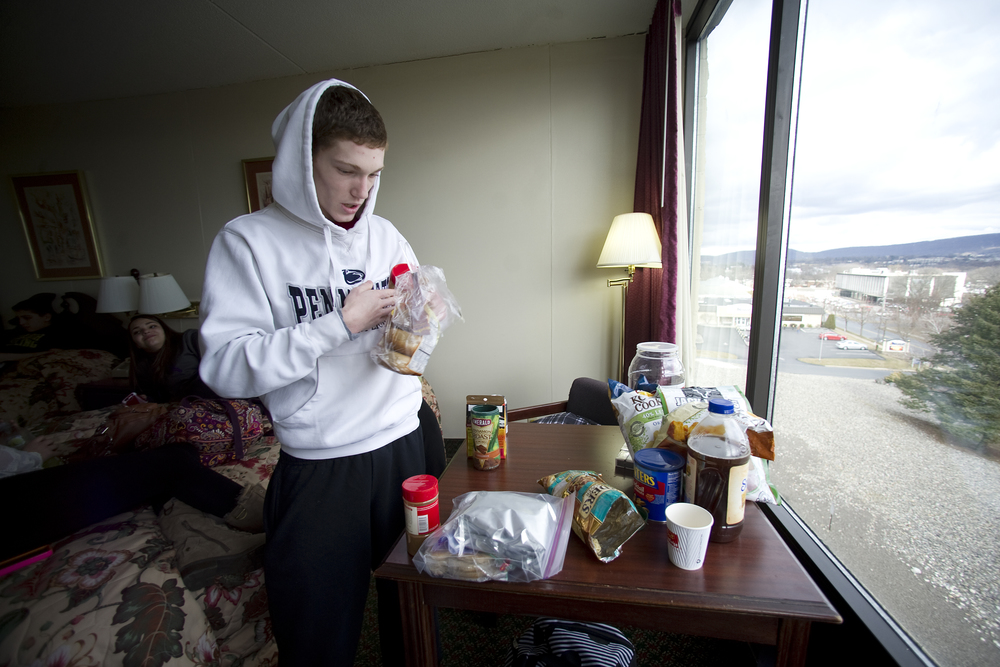 Wilson wrestler Jaryd Flank gathers a small amount of food that he will be able to eat over the course of the next couple days in a room at the Econo Lodge as he rprepares for that evening's preliminary round of the PIAA southeast regionals at Wilson High School. Express-Times Photo | MATT SMITH