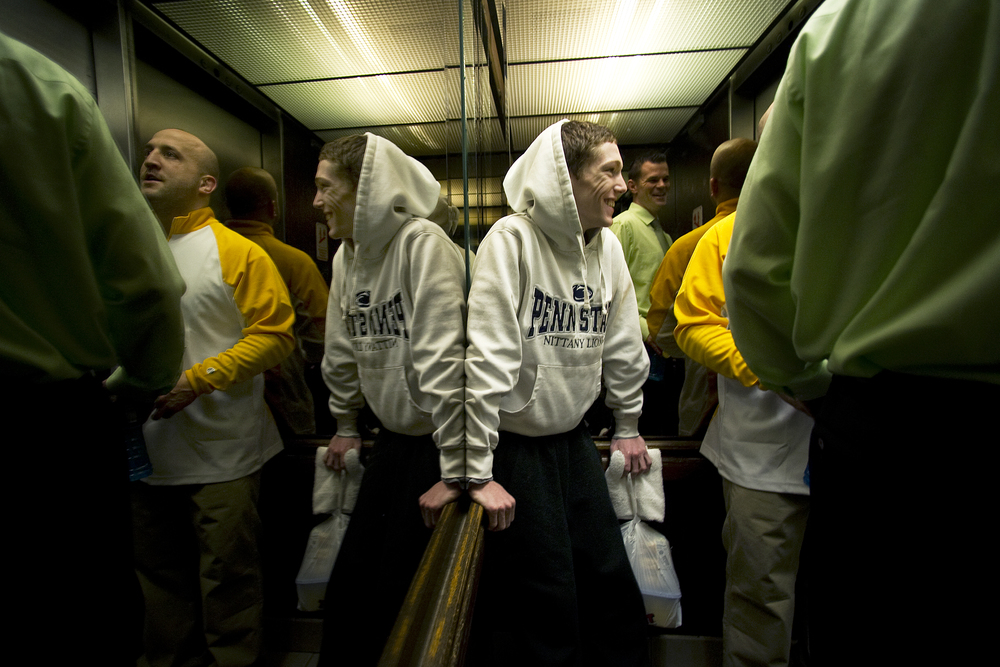 Wilson wrestler Jaryd Flank rides an elevator with coaches as he gets ready to leave the Econo Lodge he is staying at in preparation for that evening's preliminary round of the PIAA southeast regionals at Wilson High School. Express-Times Photo | MATT SMITH
