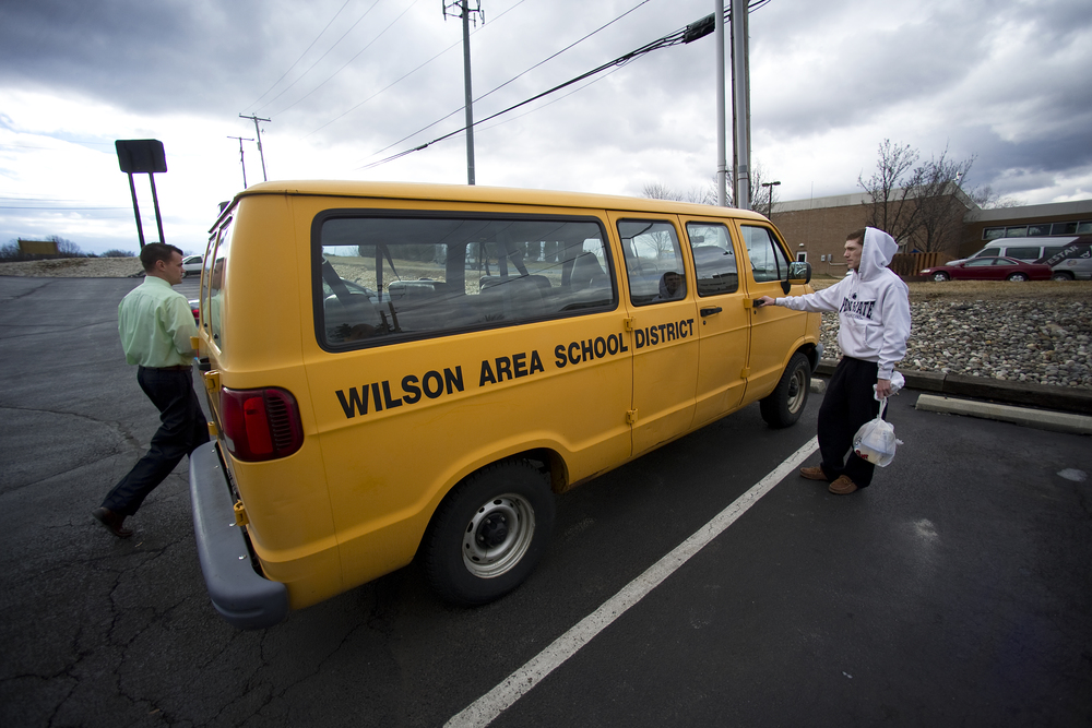 Wilson head coach Tom Mertz, left, and wrestler Jaryd Flank, right, get in a van used for travel as they leave the Econo Lodge and head to the PIAA southeast regionals at Wilson High School. Express-Times Photo | MATT SMITH