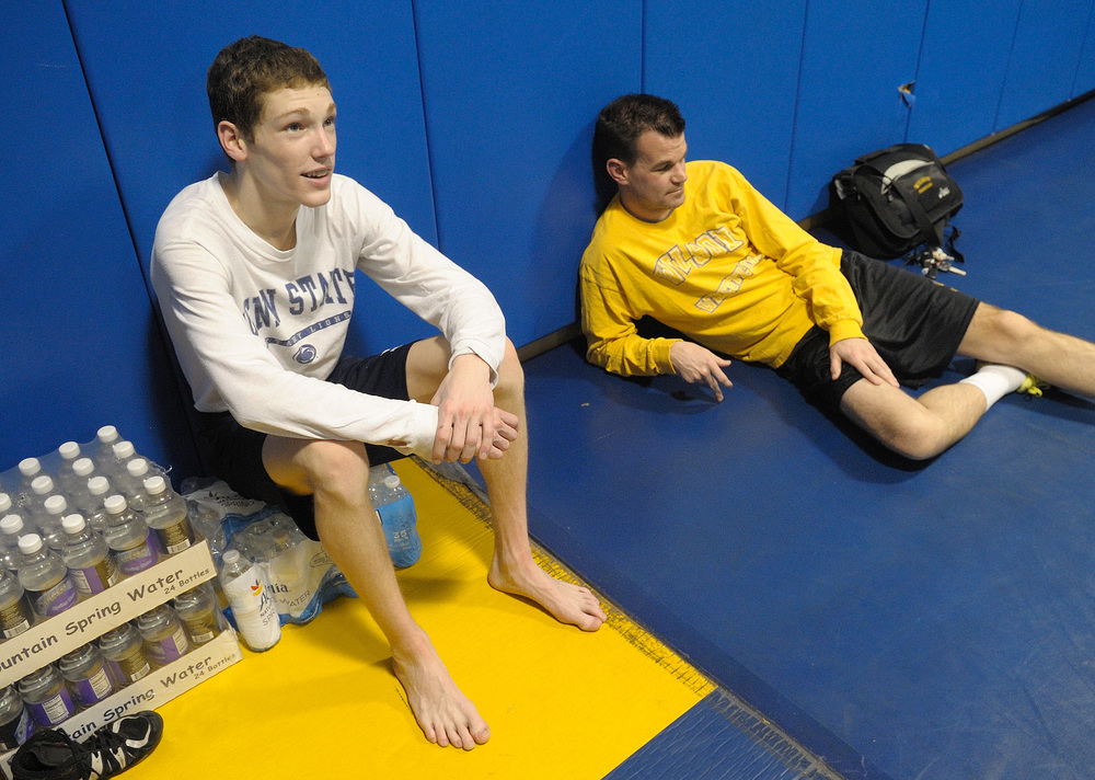 Wilson wrestler Jaryd Flank, left, and head coach Tom Mertz, right, sit and talk following the final drill session at Wilson High School before heading to the PIAA State Championships in Hershey. Express-Times Photo | MATT SMITH