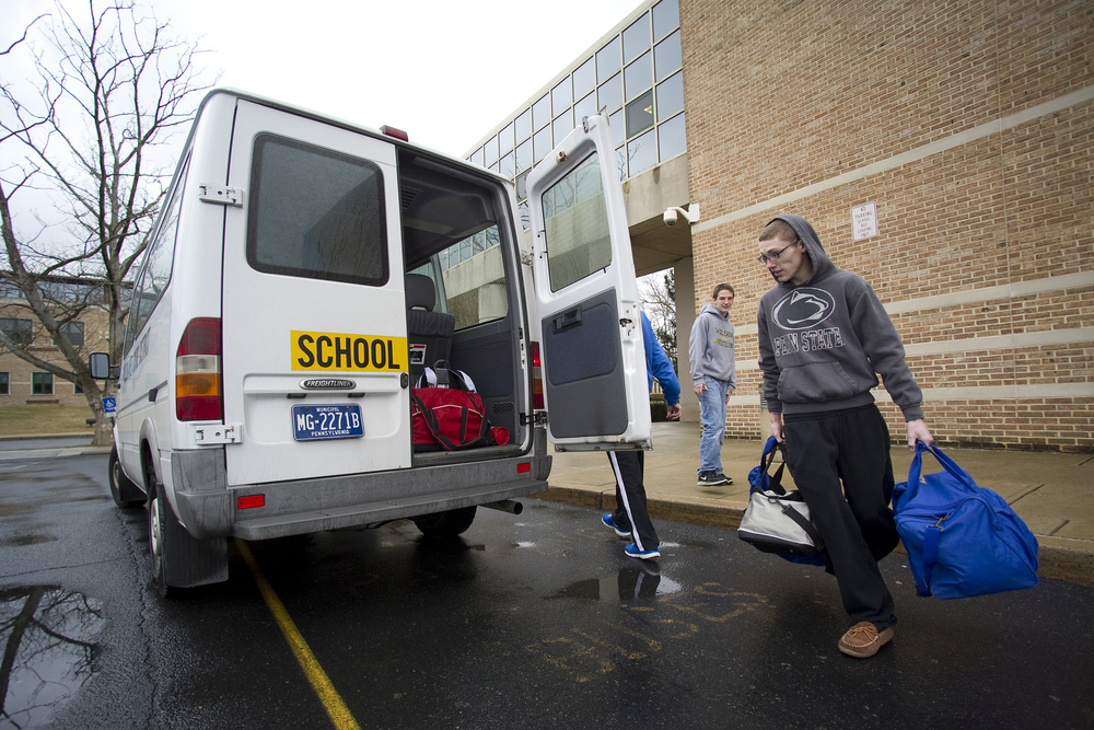 Wilson wrestler Jaryd Flank works on loading a school district van with supplies as he and his coaches leave for PIAA State Wrestling Championships at Wilson High School. Express-Times Photo | MATT SMITH