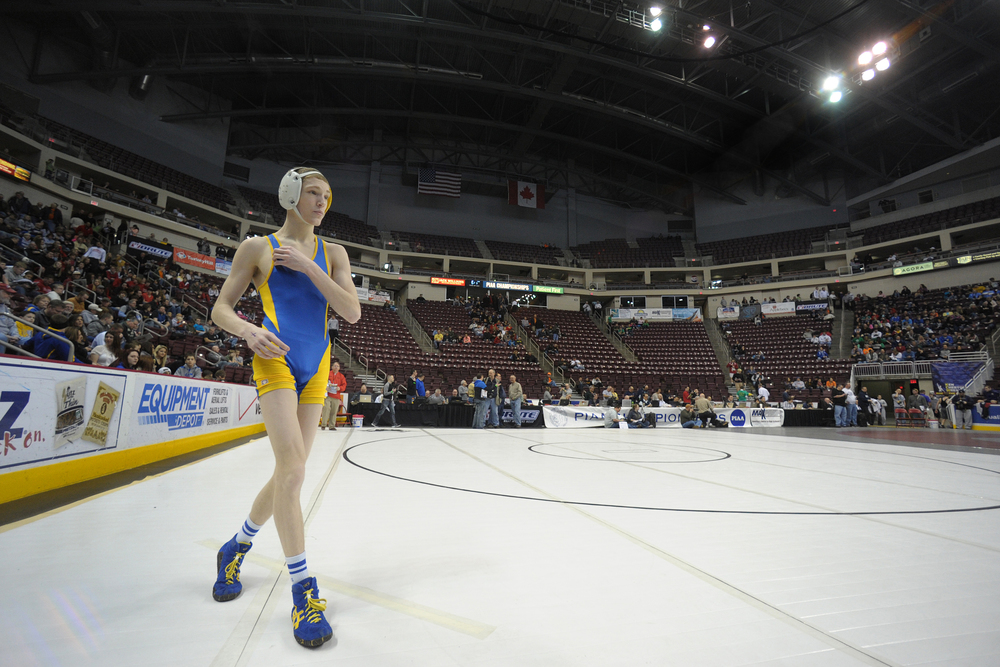 Wilson wrestler Jaryd Flank circles the mat as he warms up for his first match of the 2013 PIAA Class AA wrestling championships at the Giant Center. Express-Times Photo | MATT SMITH