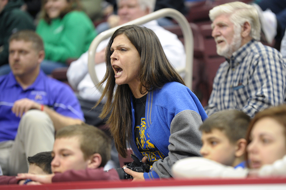 Heather Flank, mother of Wilson wrestler Jaryd Flank, shouts for her son to make something happen as time runs out on a consolation match against Line Mountain wrestler Cameron Newman in the 2013 PIAA Class AA wrestling championships at the Giant Center. Express-Times Photo | MATT SMITH