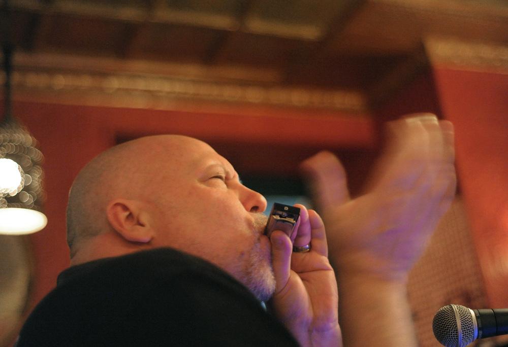 James Supra, of Fogelsville, plays the harmonica during an open mic at Riegelsville Inn.Express-Times Photo | MATT SMITH