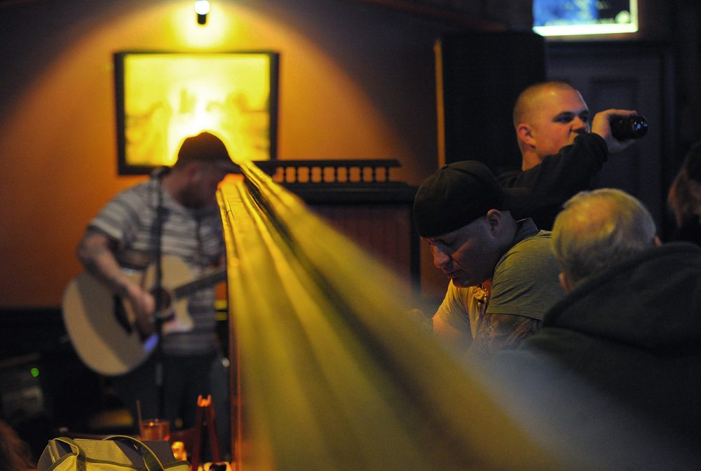 Kenny Maze, of Phillipsburg, performs as guests socialize during an open mic at The Brass Rail.Express-Times Photo | MATT SMITH
