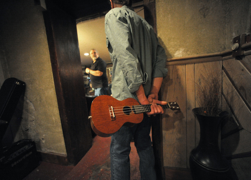 Bill Falco, of Upper Black Eddy, holds a ukulele as he waits for his set during an open mic in the Rathskeller Pub Lounge at The National Hotel.Express-Times Photo | MATT SMITH