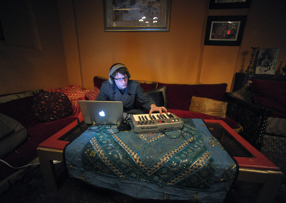Andrew Pyles, of Bethlehem, prepares music on a laptop that he will play to in his set during an open mic at Hookah Turka. Express-Times Photo | MATT SMITH