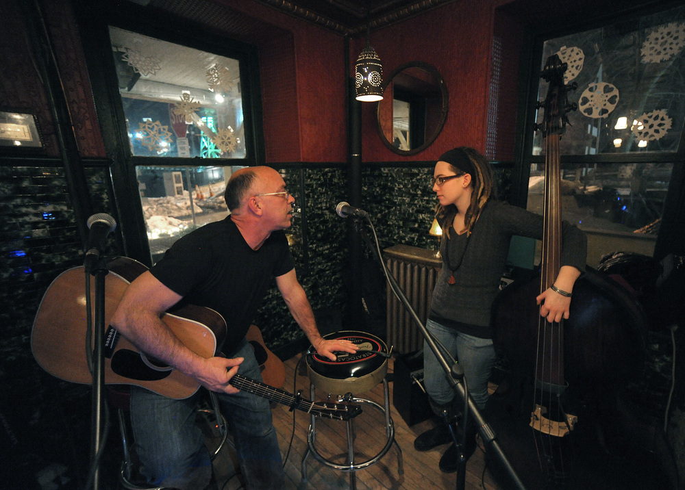 Musician Andy Killcoyne, left, talks to Sam Arace, right, of Bethlehem, about a song before they perform together during an open mic at Riegelsville Inn.Express-Times Photo | MATT SMITH