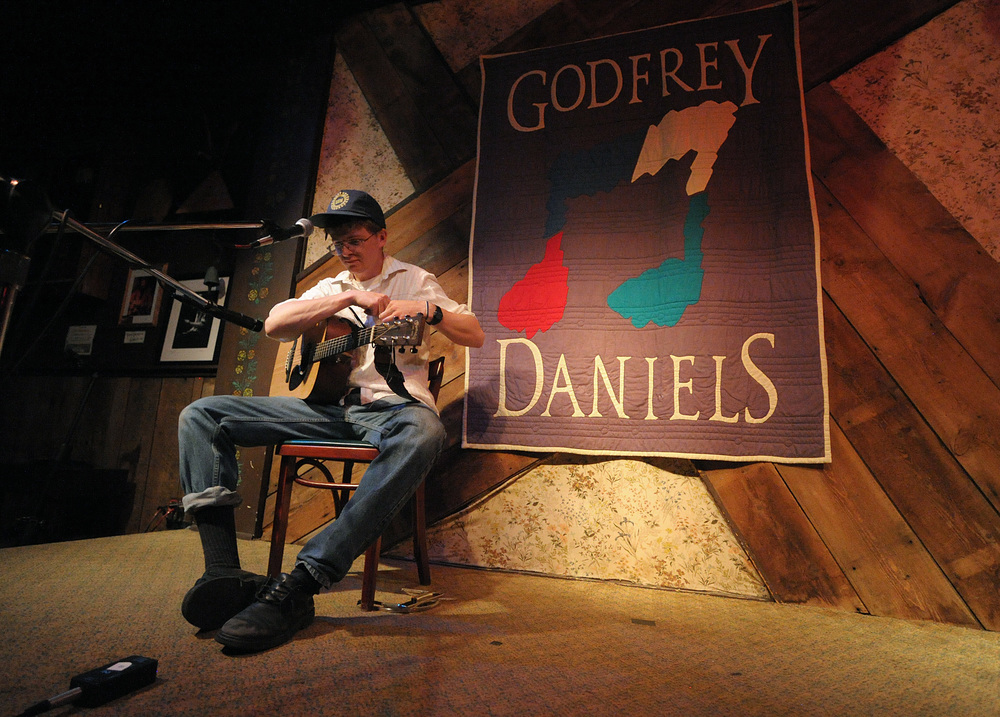Sam Steffen, of Bethlehem, puts a harmonica in his pocket after performing on stage during an open mic at Godfrey Daniels in Bethlehem.Express-Times Photo | MATT SMITH
