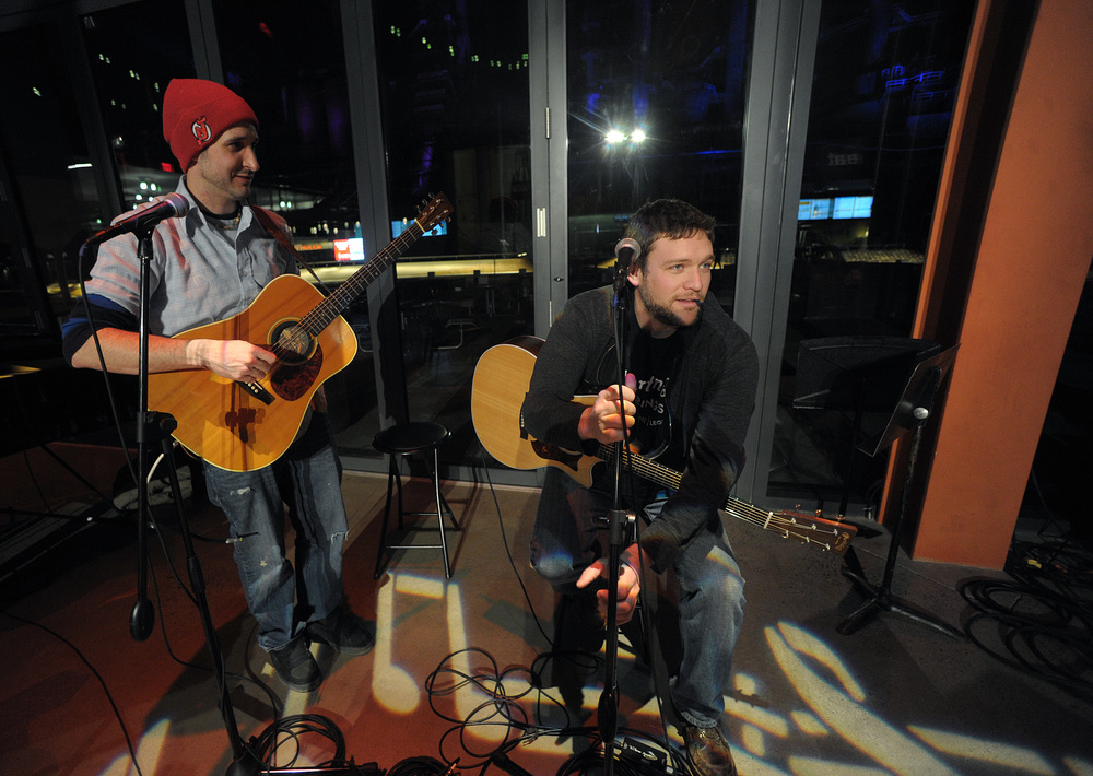 Mike Frank, left, of Stewartsville, and host Billy Bauer, right, get ready to perform together to close an open mic at the ArtsQuest Center at SteelStacks. Express-Times Photo | MATT SMITH