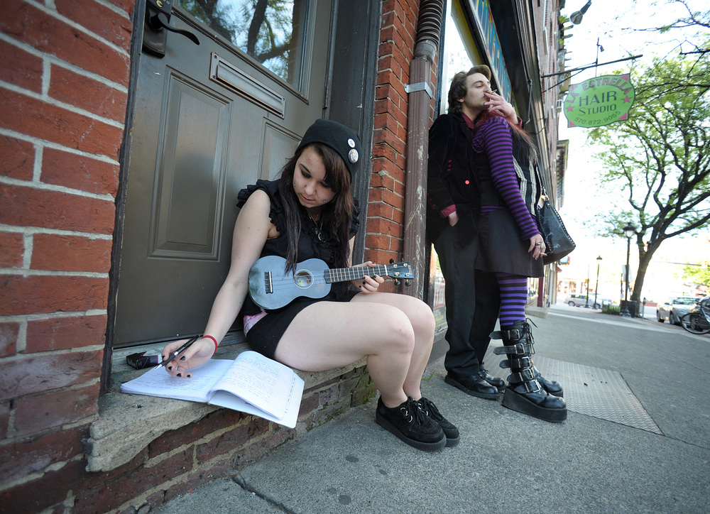 Day Andrek, of East Stroudsburg, writes down lyrics in a book before playing in an open mic at The Living Room in Stroudsburg.Express-Times Photo | MATT SMITH