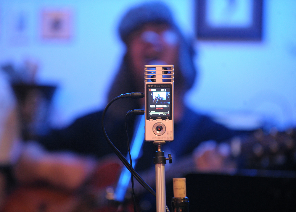 Jon Rosario, of Great Meadows, is recorded as he performs during an open mic at Mama's Restaurant and Cafe Baci.Express-Times Photo | MATT SMITH