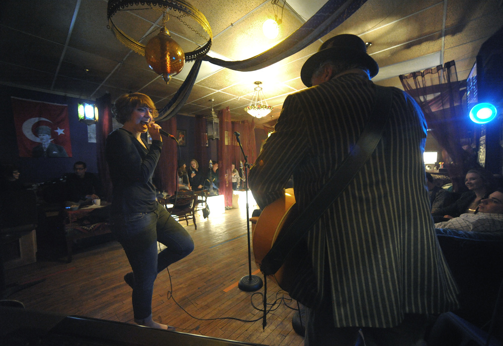 Celia Montalto, left, of Emmaus, sings as she collaborates with Bill Medei, right, who plays guitar during an open mic at Hookah Turka.Express-Times Photo | MATT SMITH