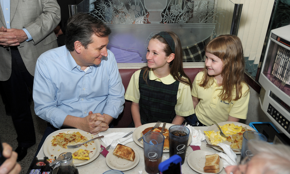 Elizabeth Trump, 10, center, of Whitehall, and her sister Meredith Trump, right, 7, of Whitehall, sit with Republican presidential candidate Sen. Ted Cruz, of Texas, as he stopped at the Hamilton Family Restaurant in Allentown, four days before Pennsylvania's primary election. (Matt Smith | lehighvalleylive.com contributor)