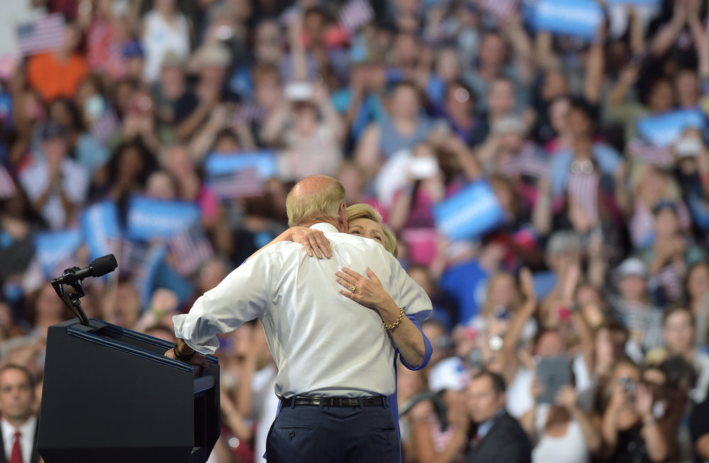 Democratic presidential candidate Hillary Clinton hugs current Vice President Joe Biden during a rally at Riverfront Sports in Scranton, Pennsylvania. Clinton has family roots in the Scranton area, which is also Biden's hometown. (Photo by Matt Smith)