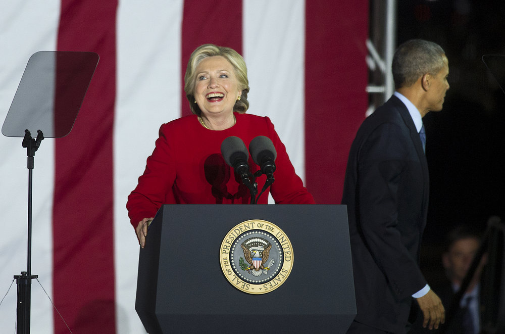Democratic presidential candidate Hillary Clinton takes the  podium as President Barack Obama exits the stage during a rally held at Independence Mall in Philadelphia, Pennsylvania. (Photo by Matt Smith)