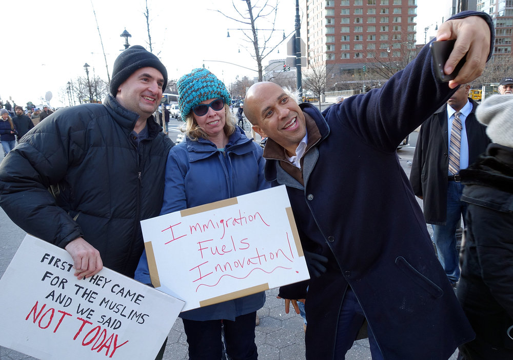 U.S. Senator from New Jersey Cory Booker poses for a photo with supporters. Over 10,000 protesters rallied at Battery Park in Lower Manhattan on Jan. 29, 2017, to voice opposition to President Donald Trump's travel ban before marching uptown to Foley Square. (Photo by Matt Smith)
