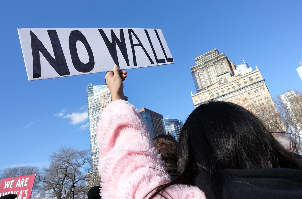 Over 10,000 protesters rallied at Battery Park in Lower Manhattan on Jan. 29, 2017, to voice opposition to President Donald Trump's travel ban before marching uptown to Foley Square. (Photo by Matt Smith)