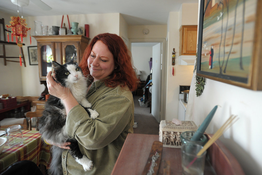 Beth Vigeant with her cat in an apartment in Frenchtown, New Jersey.