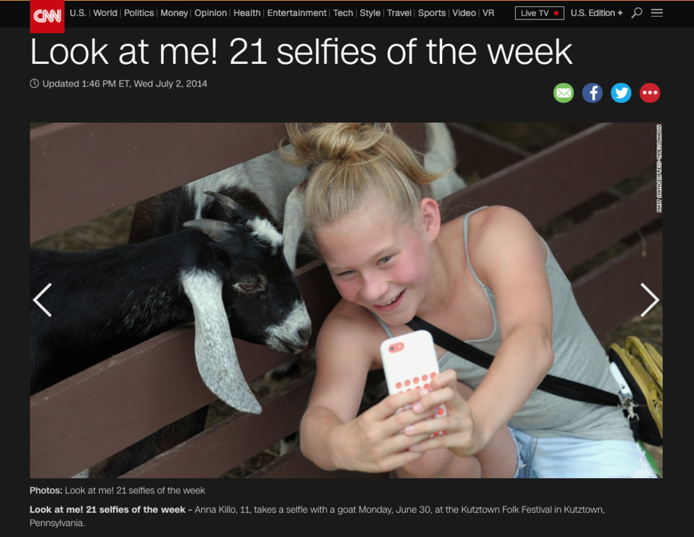 CNN Photo Gallery. A girl takes a photo of herself with a goat at the petting zoo during the Kutztown Folk Festival.