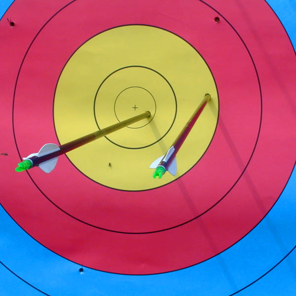 Two arrows in an archery target  by  Casito   CC BY-SA 3.0