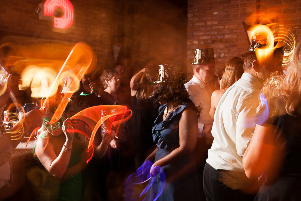 La Hora Loca; Example of Dragging the shutter at a wedding reception.