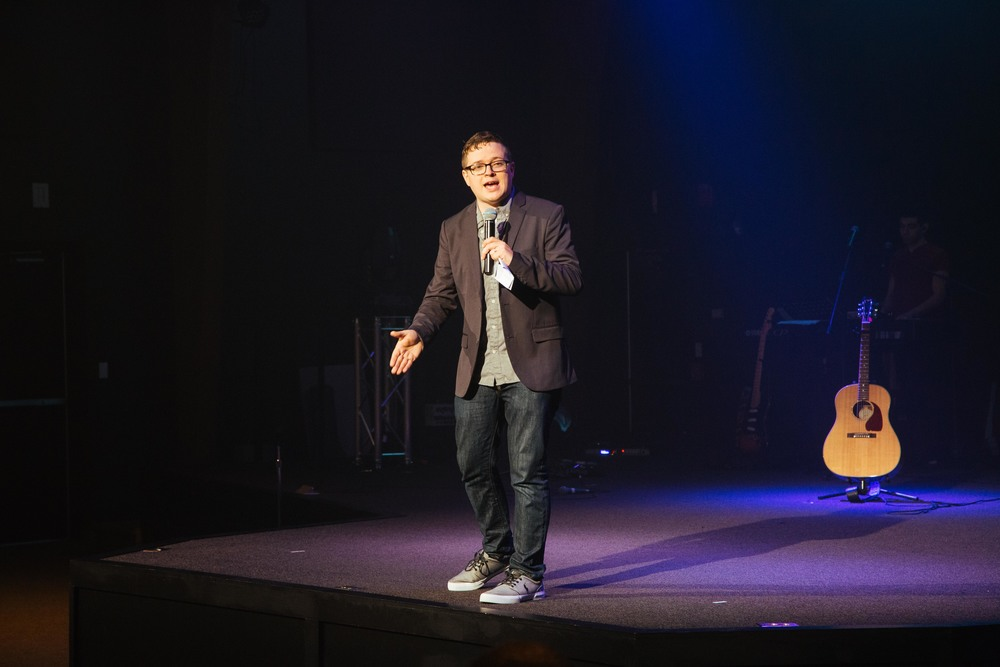 [Comedian] Pastor Josh Peterson presenting the Baby Dedication segment...