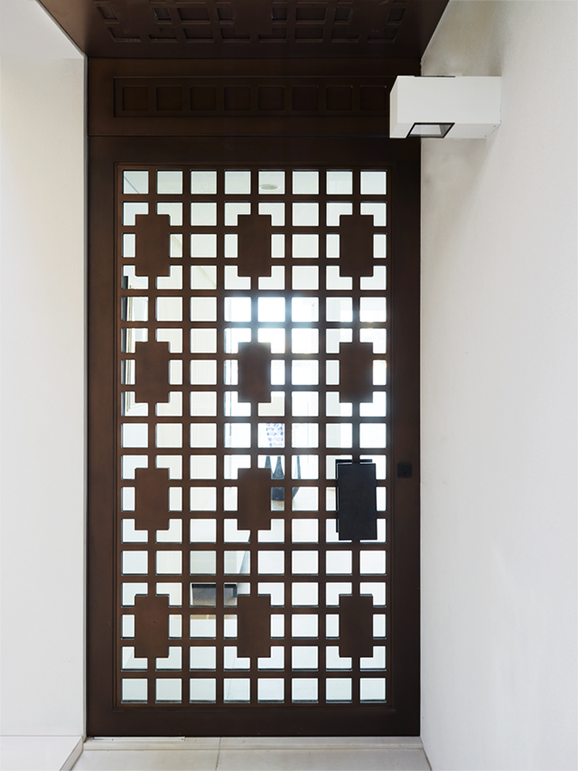 Greg Natale Screened Glass door in Treasury Bronze Cast