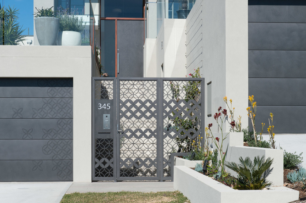 Garage, Gate and Entry Door in Graphite Pitted with custom design by Joanna Lukaszewicz