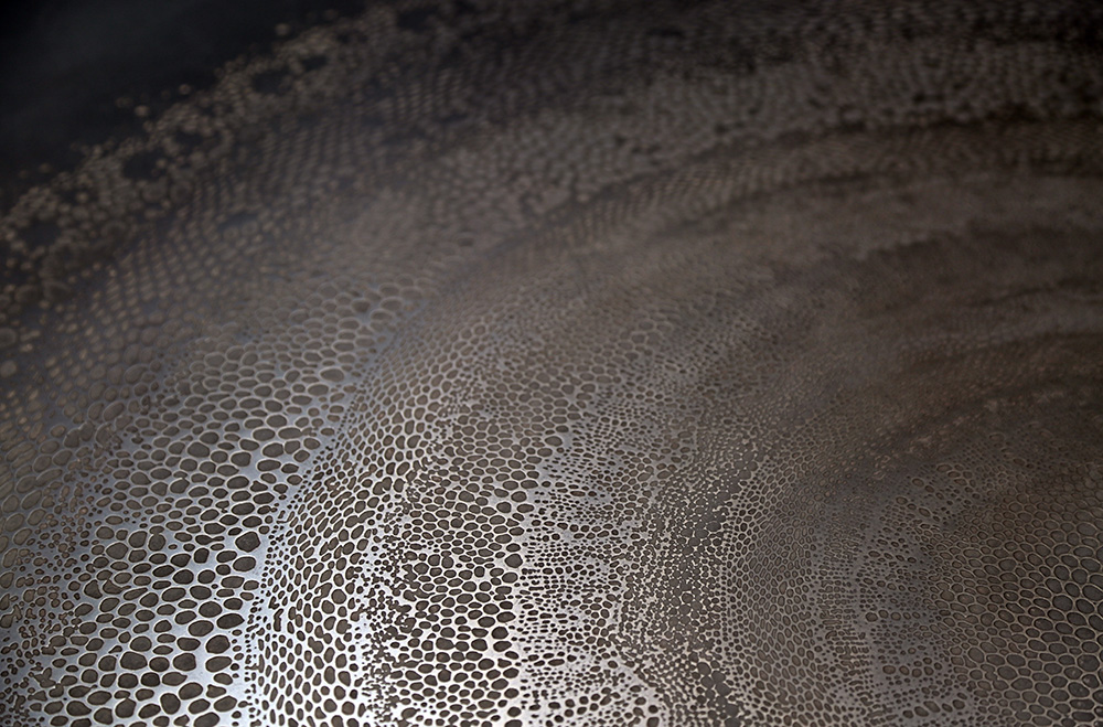The possibilities of 3D printing on any material are endless. A detail of a Nickel printed pattern by Axolotl.