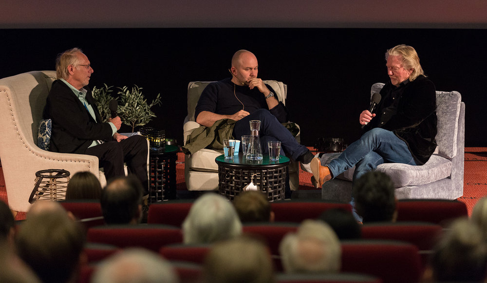 Co-host Mikkel Aaland and Artistic Director Morten Krogvold in conversation with guest photographer Sølve Sundsbøe
