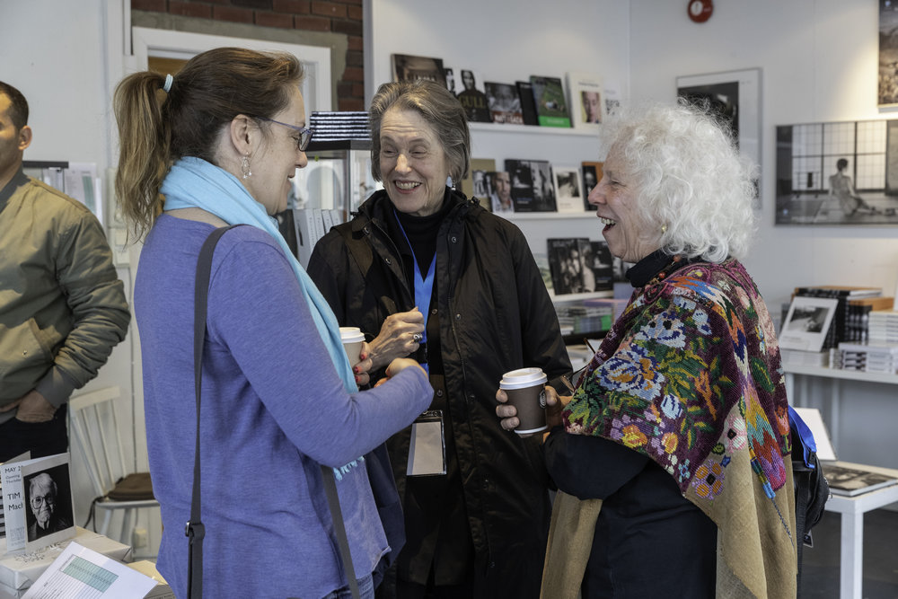 Helen Parker, Olivia Parker and Linda Connor in the festival shop between lectures