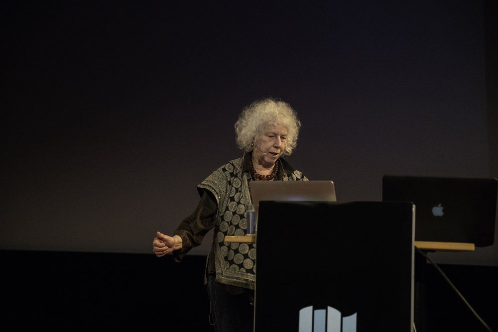 Linda Connor holding her lecture