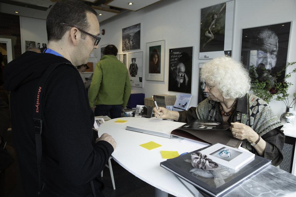 Linda Connor signing books