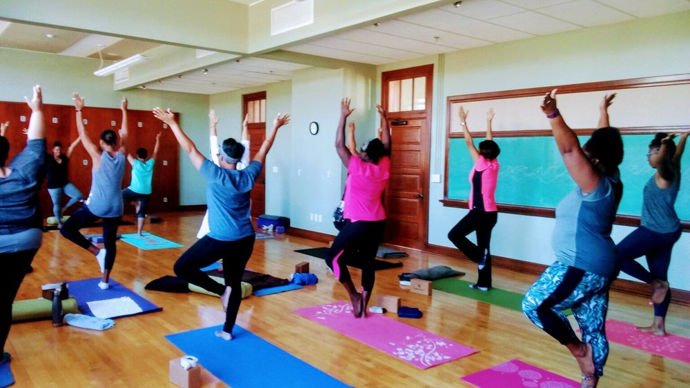 Community Programs Director Eboni Bugg, LCSW, leads a session of Yoga for Women of Color, held on the third Sunday of every month at Common Ground Healing Arts. Photograph by Yolanda C. Jones.