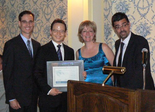 C GS Merck Frosst 2009 best resident research award presented to Michael Wan by Martin Dilauro. Left to right: Martin Dilauro, Michael Wan, Yvonne Buys, and Marcelo Nicolela.