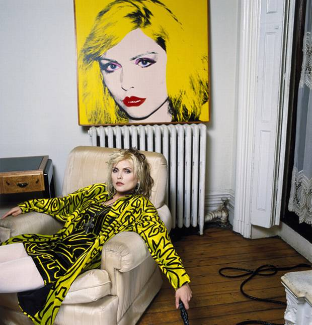 Debbie in her NY apartment in front of a Warhol portrait.