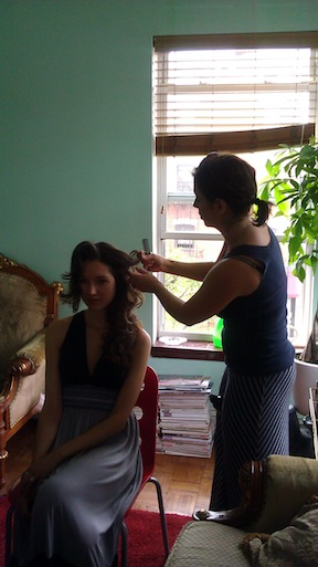 Lisa DeMaria of Salon Topaz works the models hair.