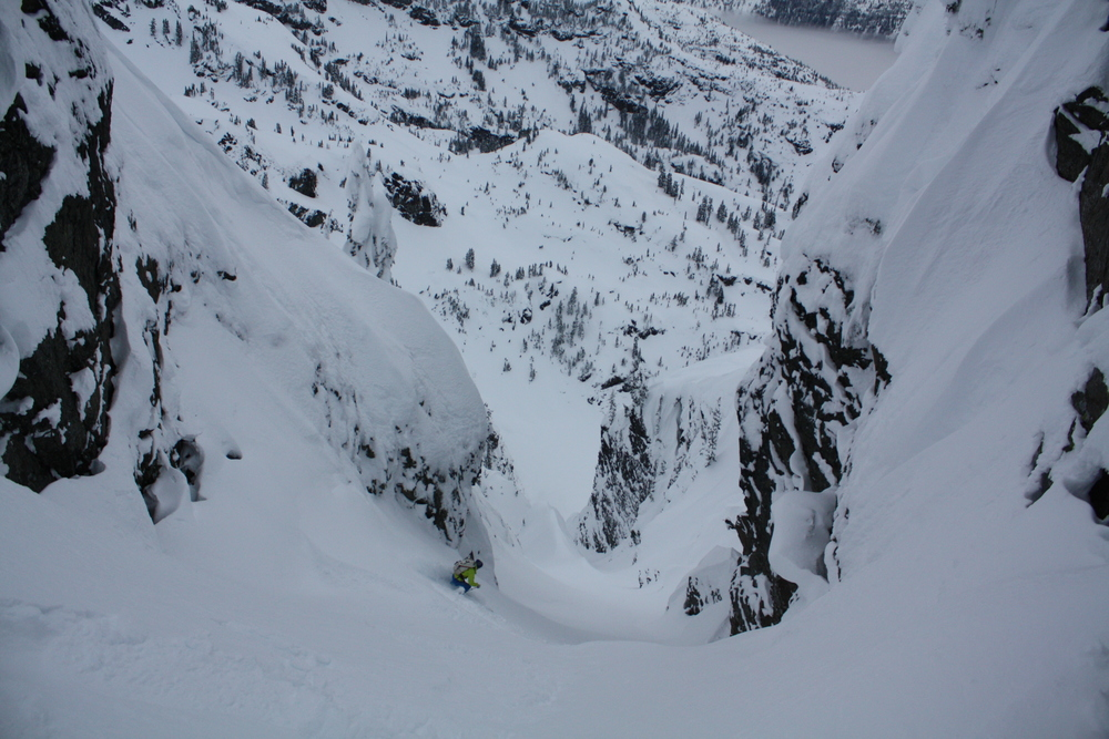 Forest McBrian laying in the first tracks ever in the NW Couloir of the Four Brothers.