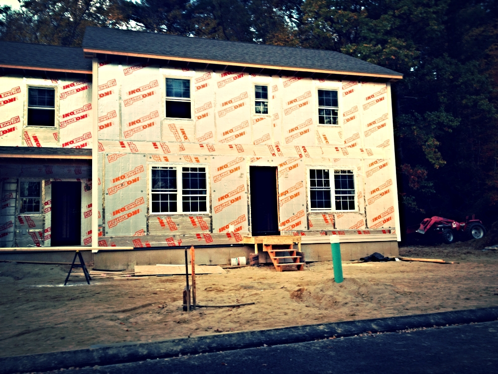 Insulated sheathing with seams taped is a good primary air barrier.