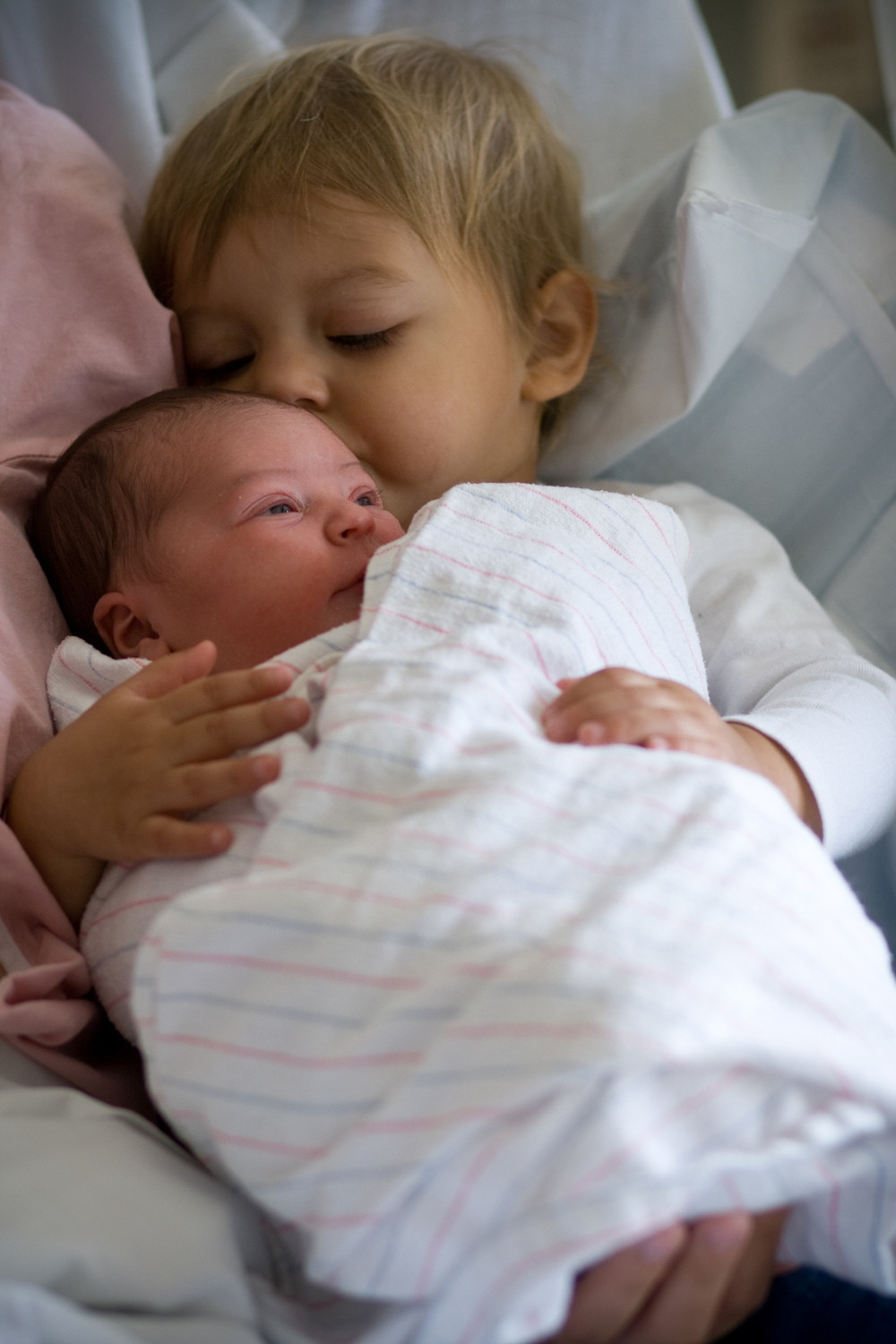 Pax and Aila, the day after she was born.