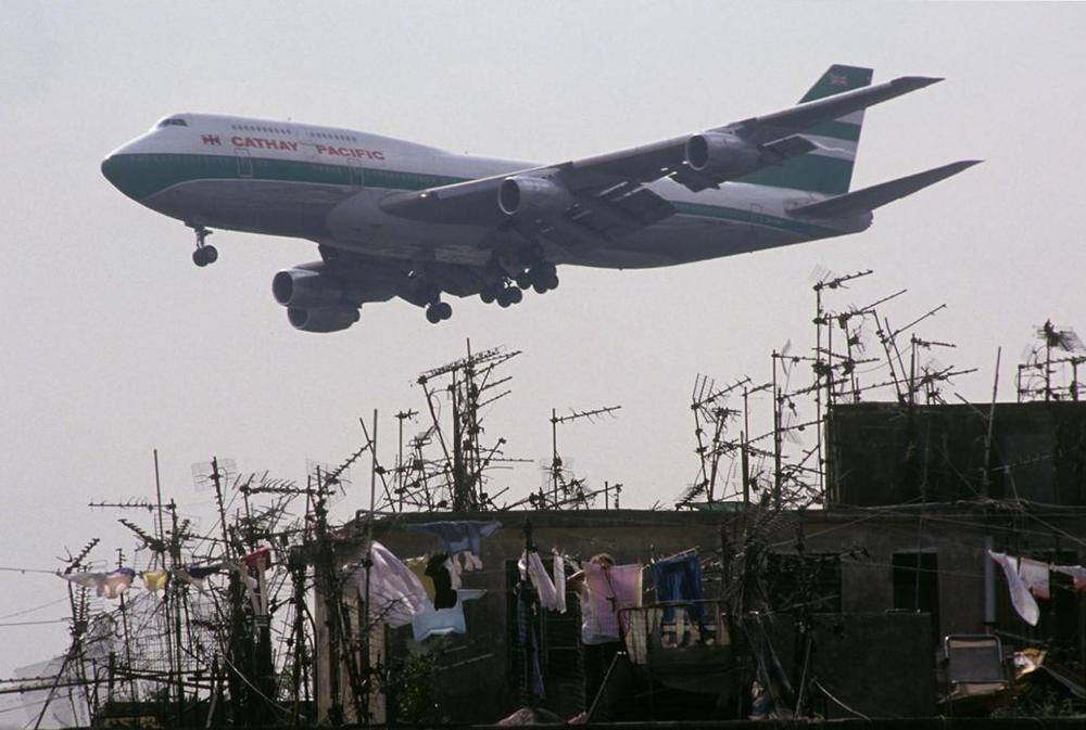 Cathay Pacific jet passing Walled City rooftops 1989.jpg
